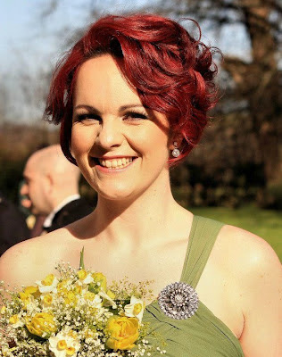 Bridesmaid with short red bob for a wedding hairstyle