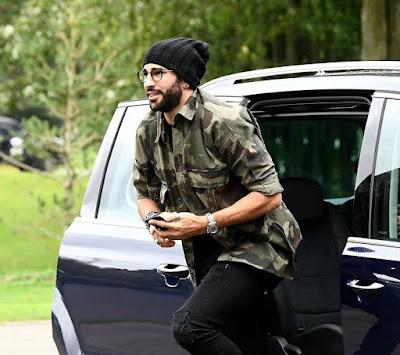 Adil Rami coming out of his car