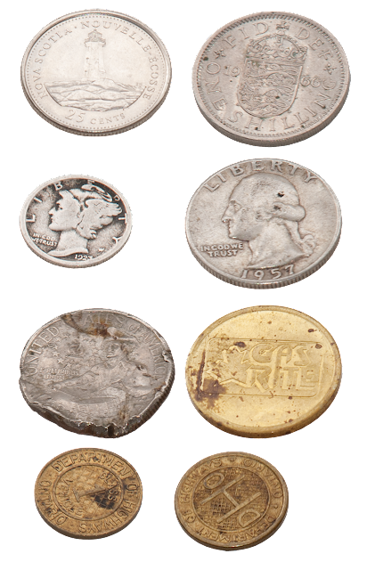 A series of old coins and tokens.