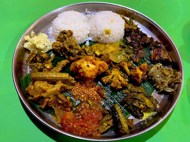 Plate full of delicious items at Odiani Hotel, Panikoili