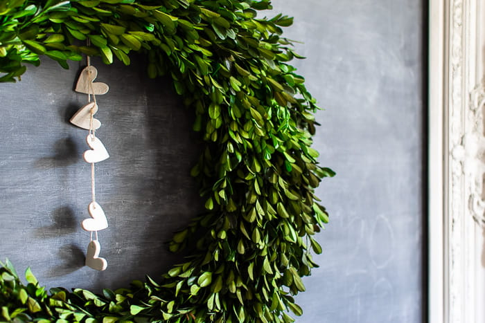 clay hearts hanging from boxwood wreath