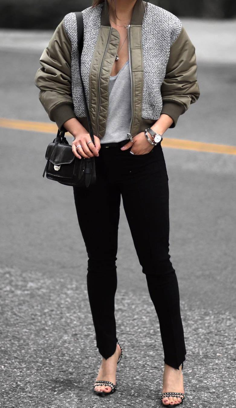 what to wear with a bomber : black bag + skinnies + heels + grey top