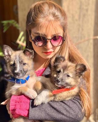 Dananeer Mobeen with her pet dogs