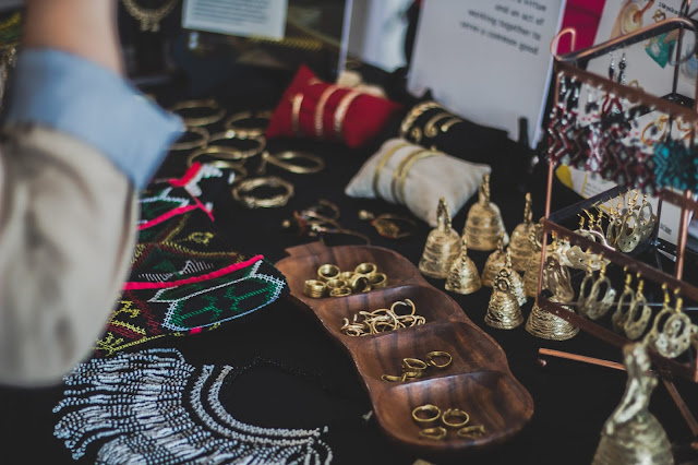 A variety of jewelry on display at a bazaar.