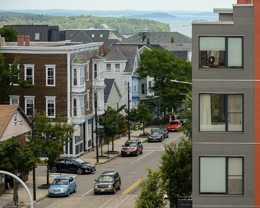 Portland, Maine USA July 2019 photo by Corey Templeton. A glimpse of Casco Bay over Congress Street, from the Portland Observatory.