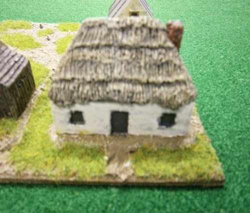PS39 WWII Russian thatched hut, rendered walls