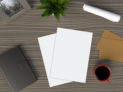 3D Wooden desk with notebook and flyers mockup psd