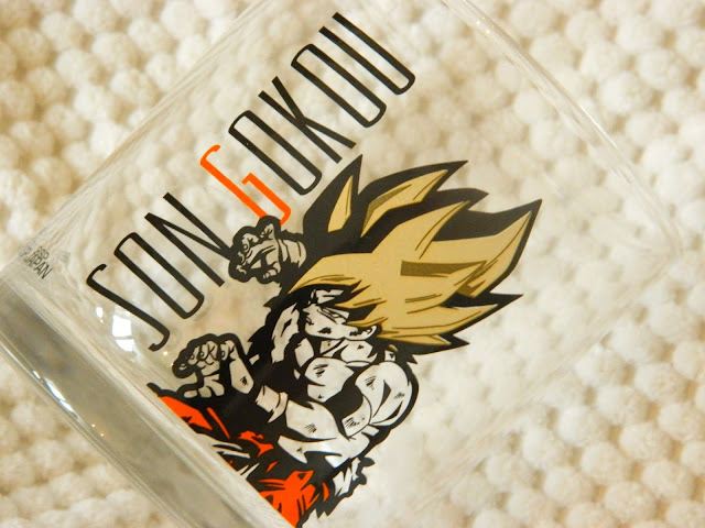 A glass with a picture of Goku, a character from Dragon Ball Z