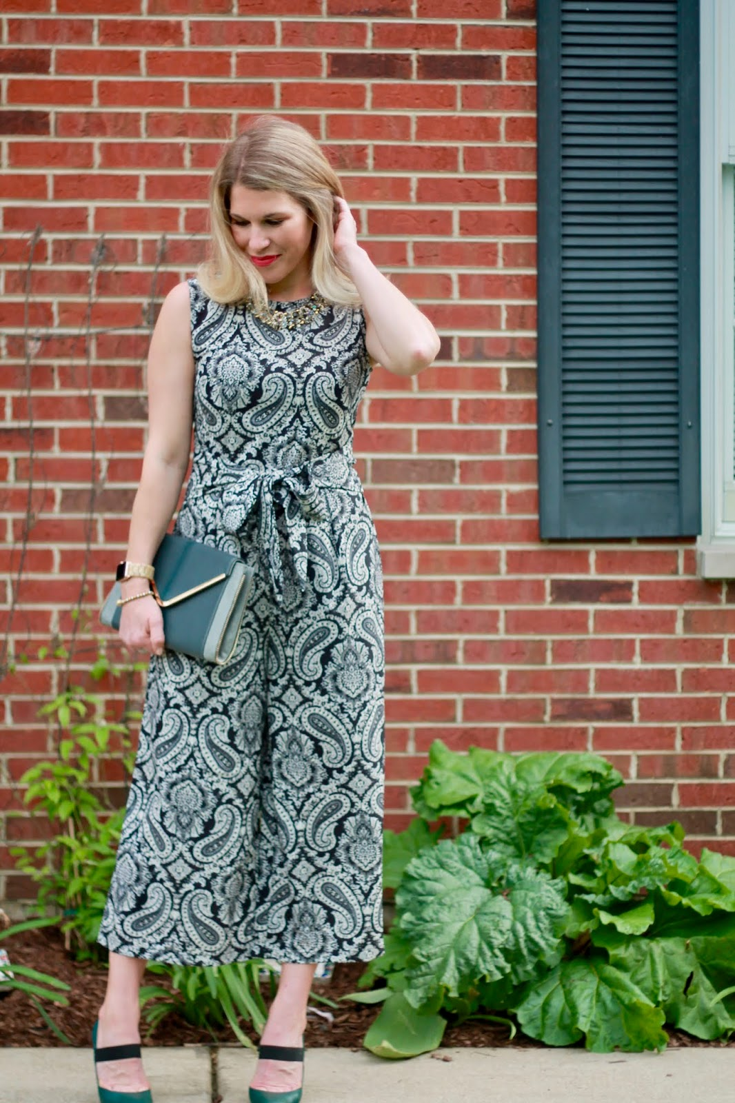 paisley jumpsuit, grey envelope clutch, green pumps, summer date night outfit