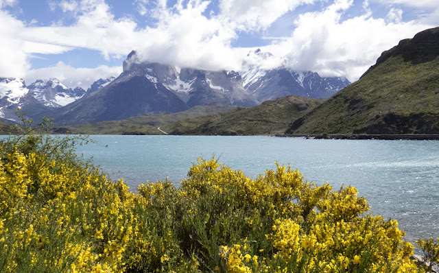 Lake with mountains behind and picturesque clouds in Torres del Paine National Park in Patagonia