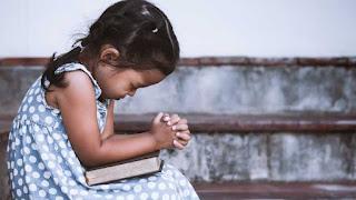 A praying child
