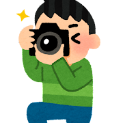 カメラで撮影をしている人のイラスト