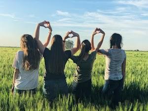 Women forming heart gestures
