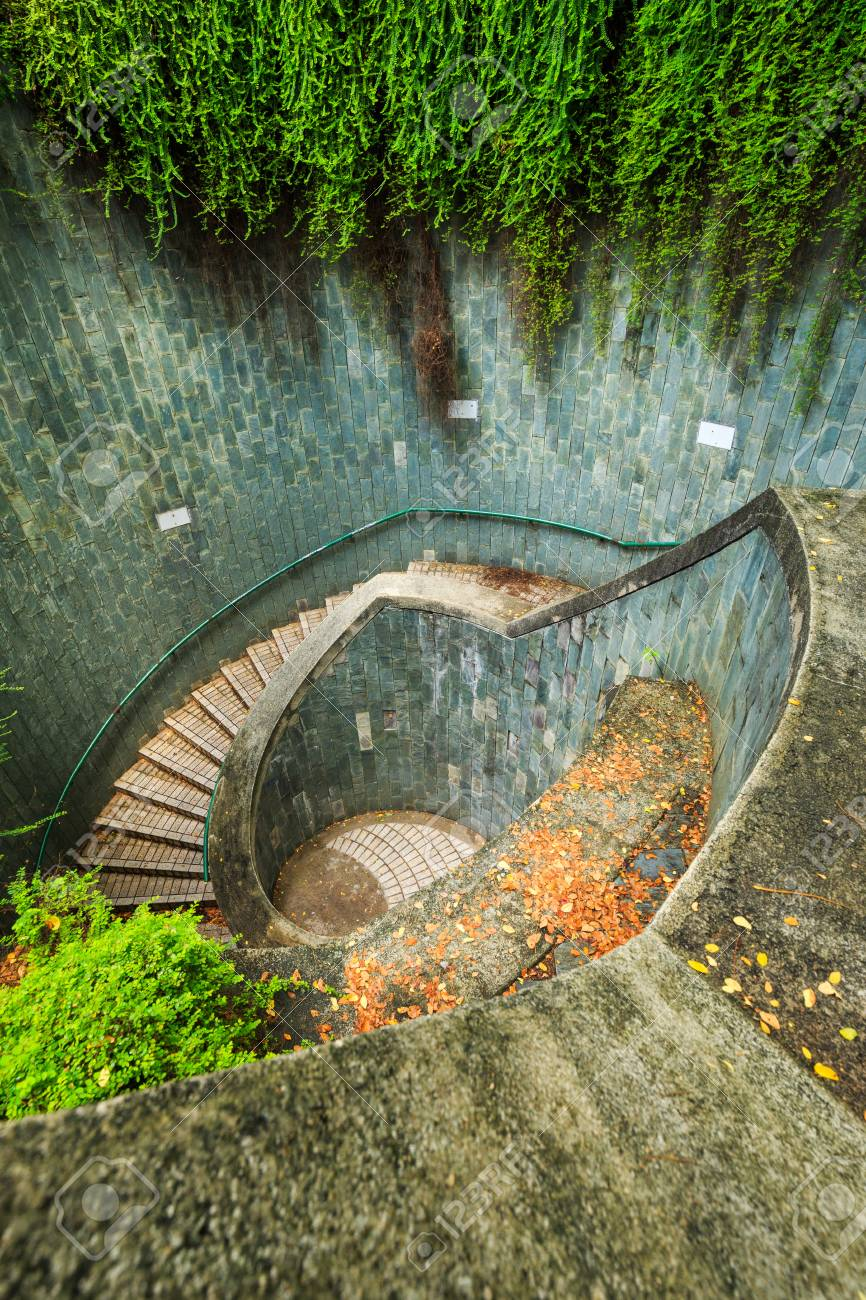 Giant Spiral Staircase of underground crossing in tunnel at Fort Canning Park.