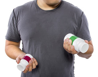 Man reading the labels of over the counter vitamins.