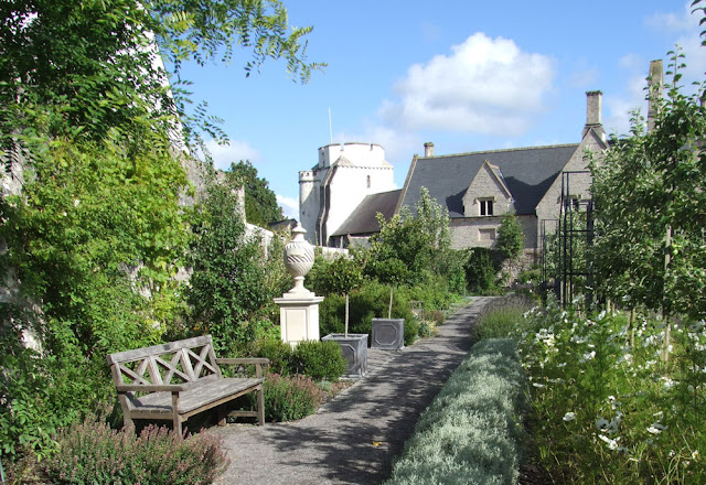 Cowbridge Physic Garden with Holy Cross church tower and Old Grammar School in background.