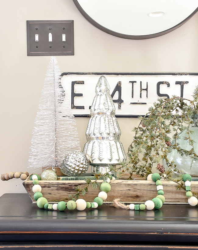 Silver trees, bottle brush trees and green wood bead garland