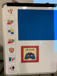large magnetic white board with schedule of activity visuals arranged vertically alongside a large magnetic flannel piece