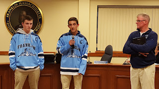 2 of the 4 team captains helped present the full team to the School Committee assisted by Coach Spillane