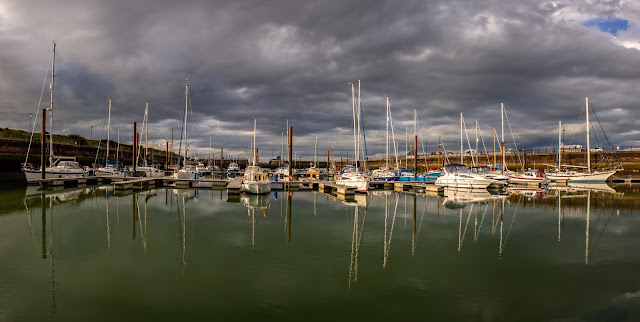 Photo of reflections in the still water at Maryport Marina on Sunday evening