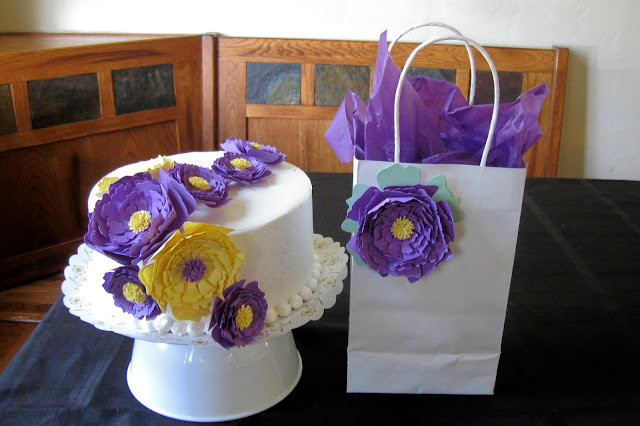 This is a birthday cake and paper gift bag I decorated with paper peony flowers
