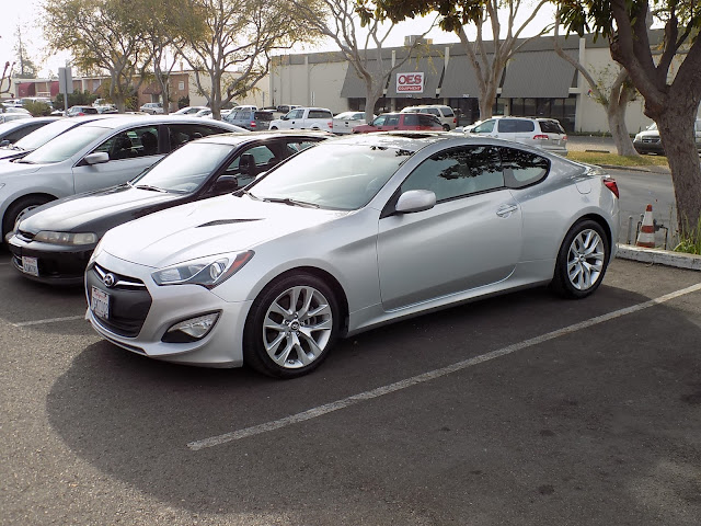 2014 Hyundai Genesis Coupe with damaged fender, door & quarter panel after repairs at Almost Everything Auto Body