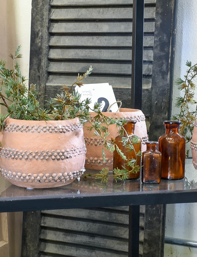 terra cotta vases and amber bottles