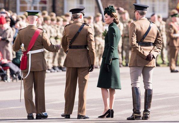 Alexander McQueen deep green coatdress, Kiki tourmaline earrings, Gianvito Rossi pumps