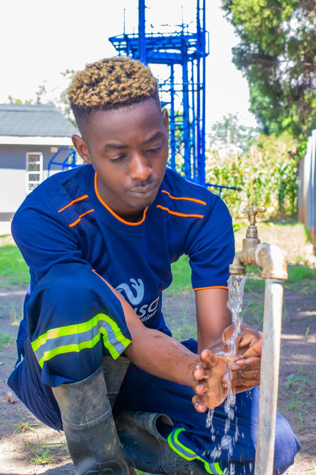 Handwashing: Clean Hands Save Lives (Ray Vines Washes Hands with Nakiso Borehole Drilling)