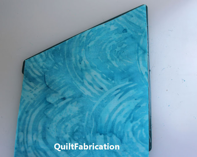 aqua fabric strips on a triangle die