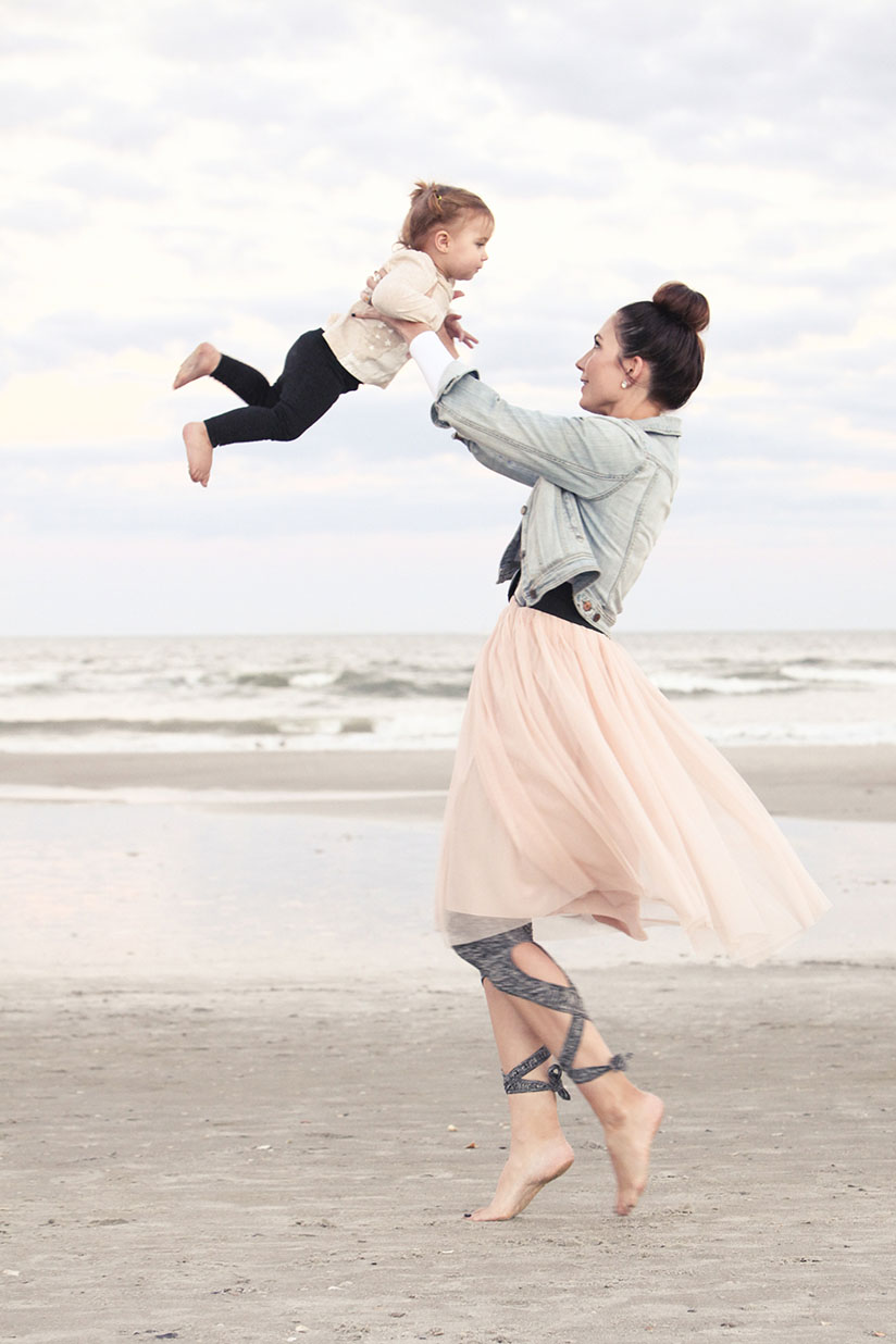 Amy West and daughter play on the beach in ballet inspired fashion