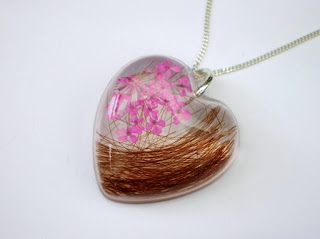 Hair and pink lace flower heart shaped pendant