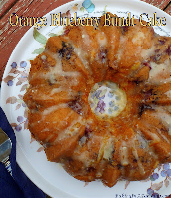 Orange Blueberry Bundt Cake, full of fruit flavor, this cake is studded with blueberries and mandarin oranges, and is drizzled with an orange topping. | Recipe developed by www.BakingInATornado.com | #bake #cake