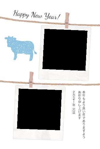 二枚のポラロイドの写真フレームと牛のガーリー年賀状(丑年・写真フレーム)