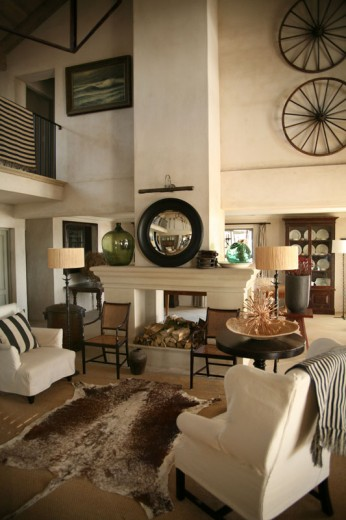 Roses and rust a beautiful beach house - How to decorate high walls with cathedral ceiling ...