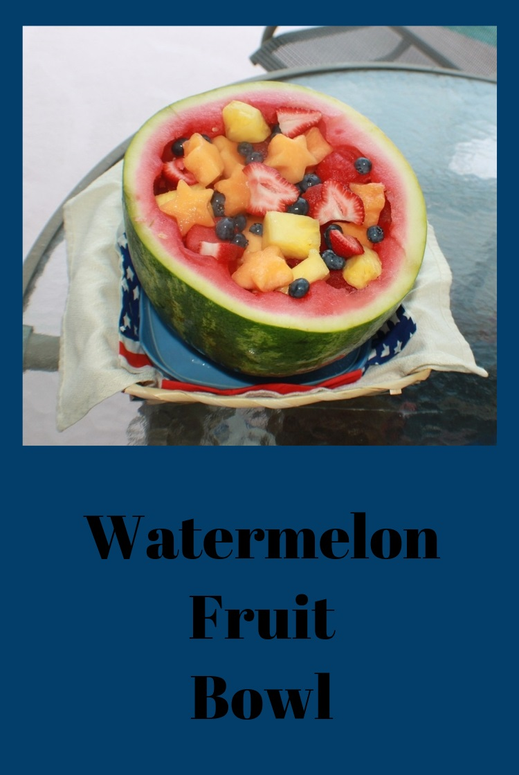 Watermelon cut in half and carved into cookie cutter shapes for a festive 4th of July fun colorful fruit bowl that edible
