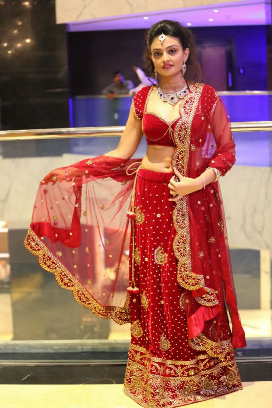 Glamorous Nikitha narayan in ethnic Indian red lengha choli dress