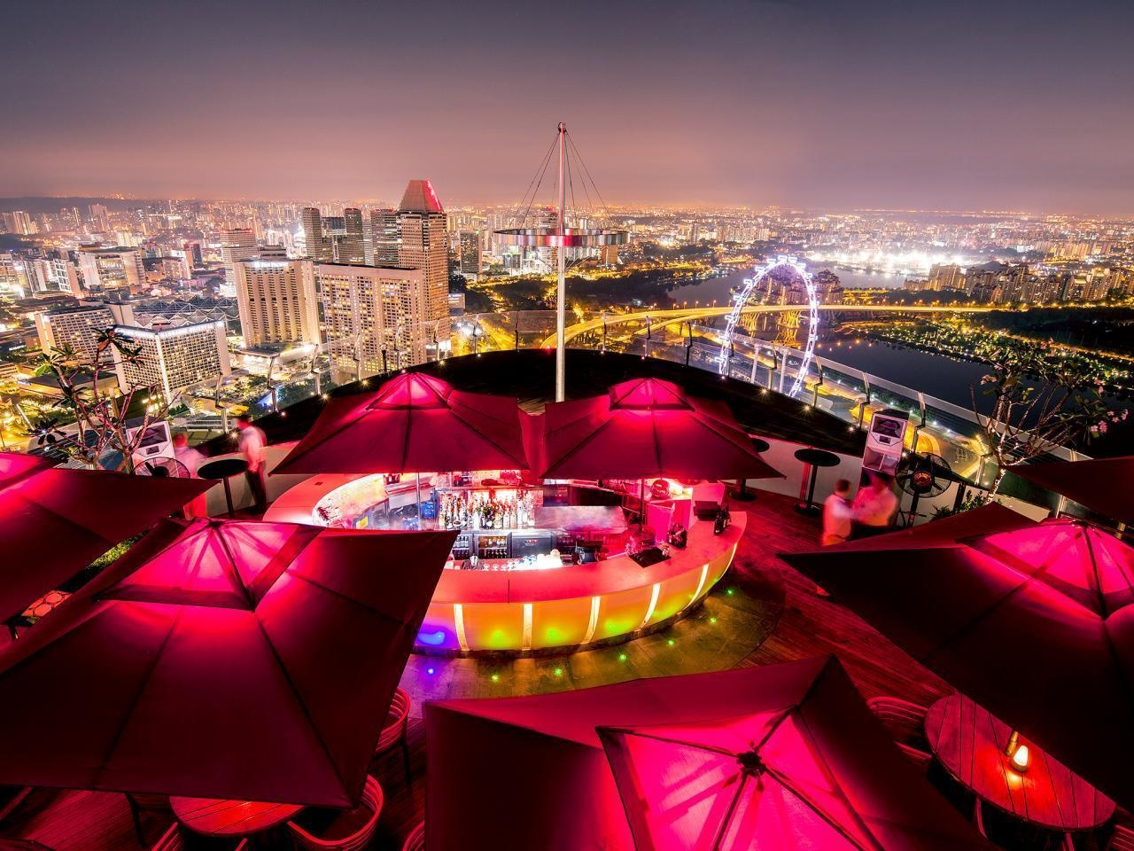 The World's 30 Best Rooftop Bars… Everyone Should Drink At #9 At Least Once. - Guests enjoy Singapore's skyline at the Ce La Vi.
