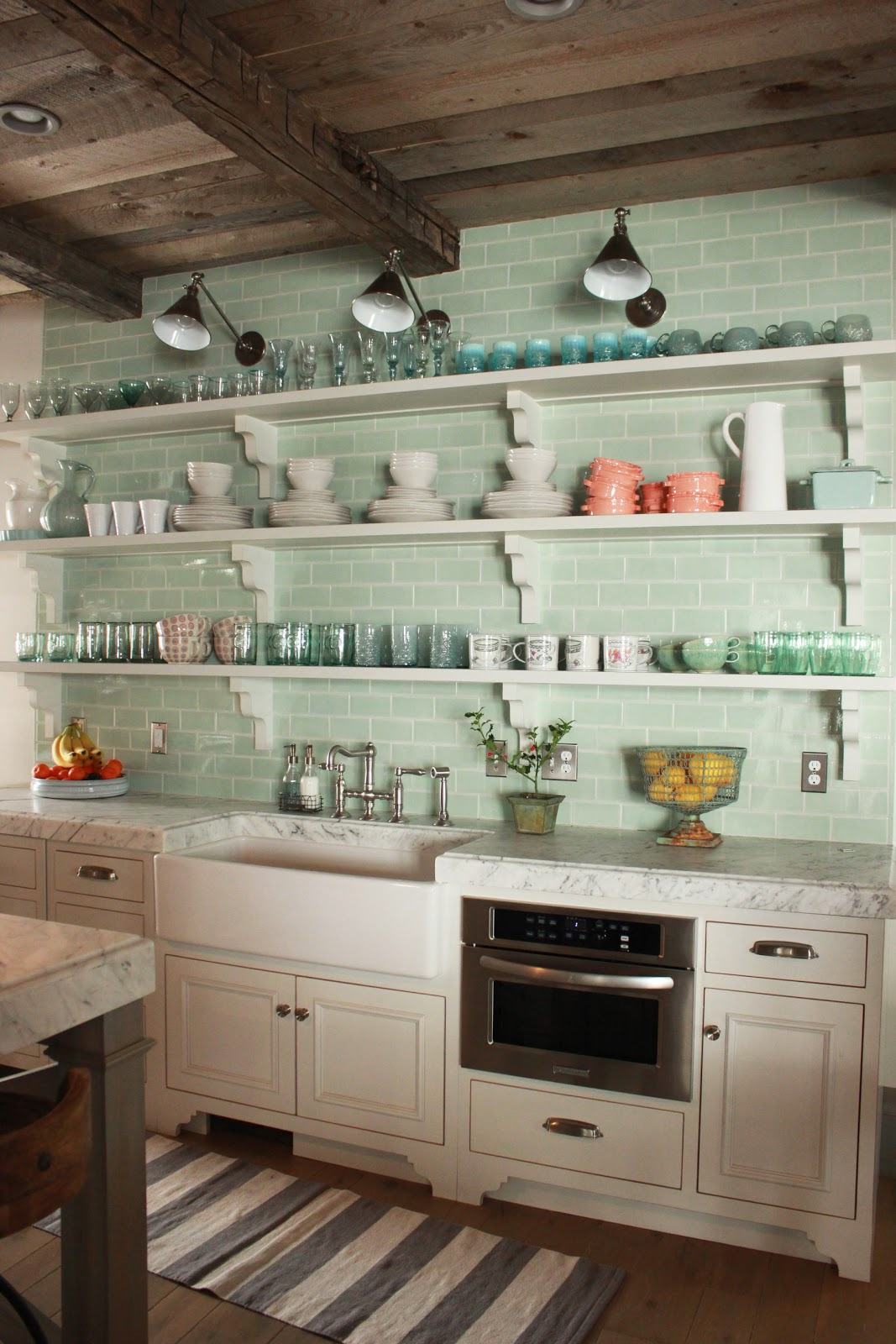 Open shelving and green subway tile in rustic #Frenchfarmhouse with wood ceilings