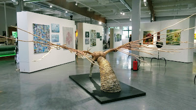 A photo of a sculpture with wooden wings.