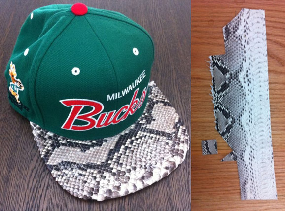 Kanye West s road manager Don C is now Designing custom snakeskin  adjustable hat that Kanye   Jay Z wears. The Mitchell   Ness Chicago Bulls  hat features ... 8edaaa4c190