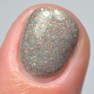 grey glitter nail polish close up swatch