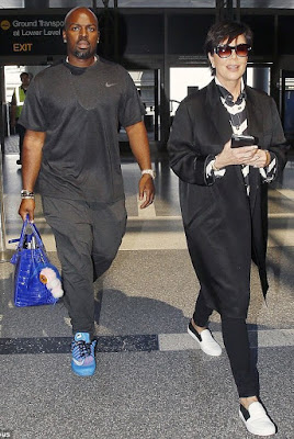 Kris Jenner's toyboy Cory Gamble Pictured Carrying Her Bag At The Airport (See Photos)
