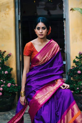 Style traditional Indian silk saree with statement antique jewelry for a festive look.
