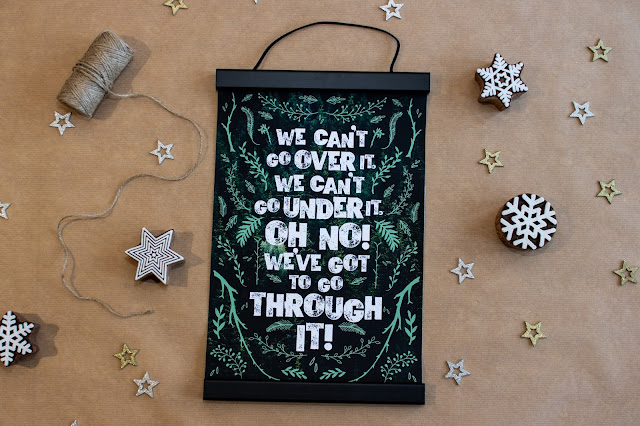 """A print saying """"we can't go over it, we can't go under it, Oh No! We've got to go through it!"""" in a magnetic hanging frame"""