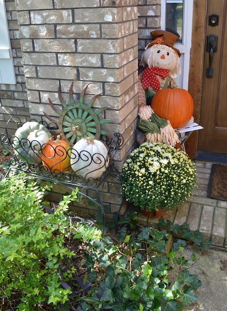 Scarecrow, mums, designer pumpkins