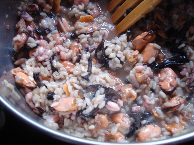 Add the seafood and wine to the risotto