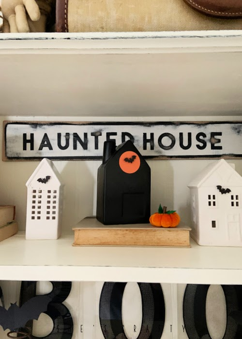 Halloween Home Decor - living room cupboard, ceramic houses, haunted house sign