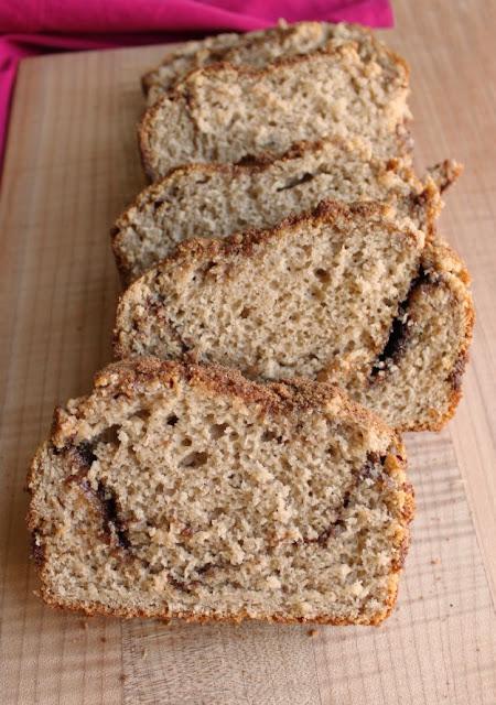 slices of cinnamon swirl bread on maple cutting board