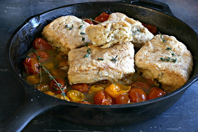 Recipe for a biscuit topped savory cobbler with tomatoes, balsamic vinegar and fresh thyme.